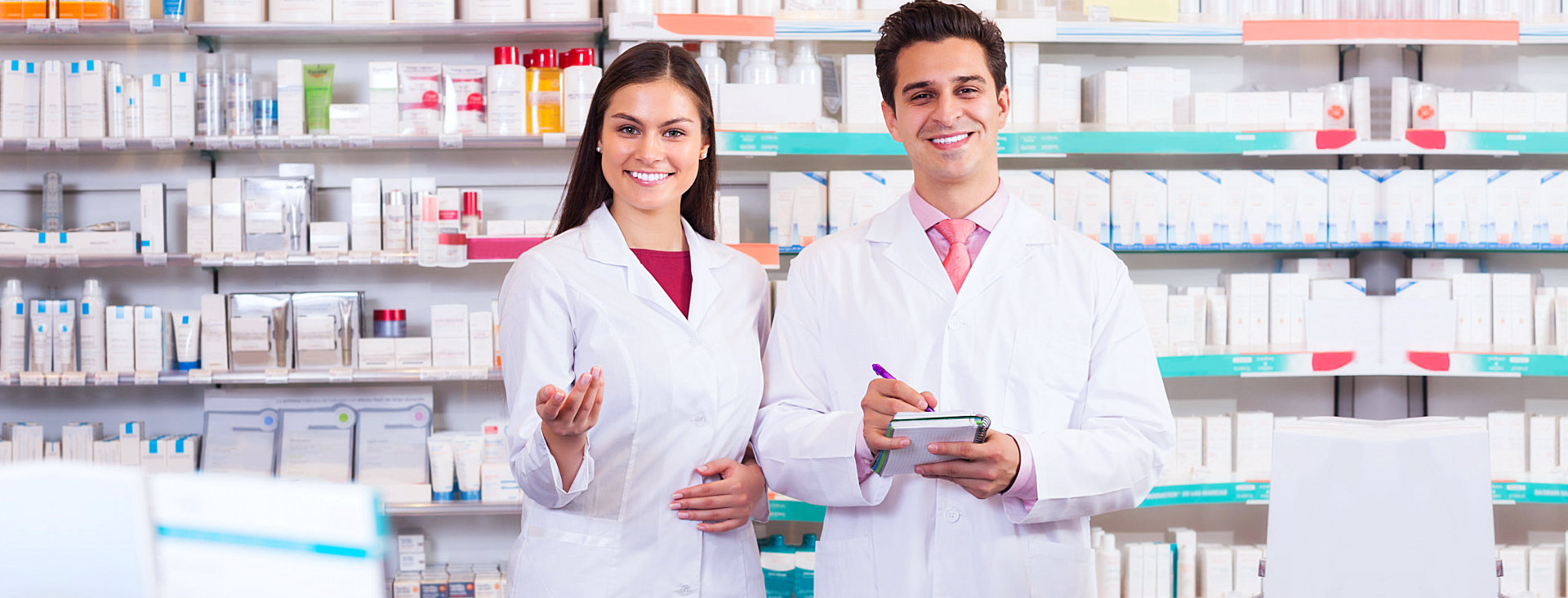man and woman pharmacist smiling