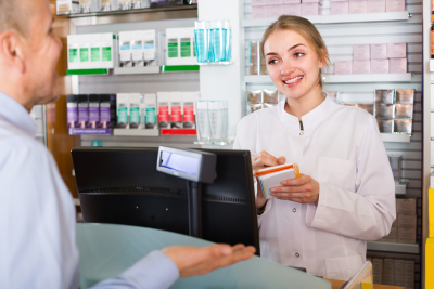 young female pharmacist serving in pharmacy